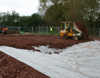 Lining a pond for great crested newts on a housing development