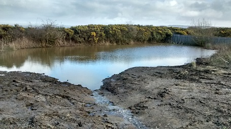 Filling up the new pond at Primrose Valley, Filey