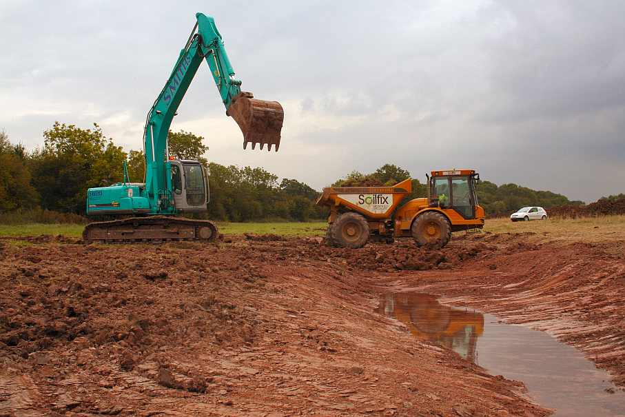 Wetland creation digger excavation at Hartpury National Perry Pear Collection