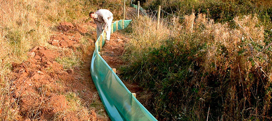 Temporary great crested newt fencing on a housing development