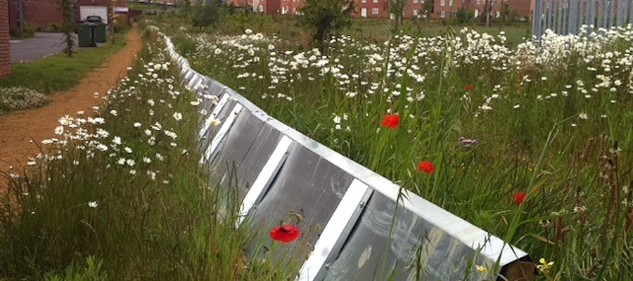 Permanent great crested newt fencing using steel panels on a housing development