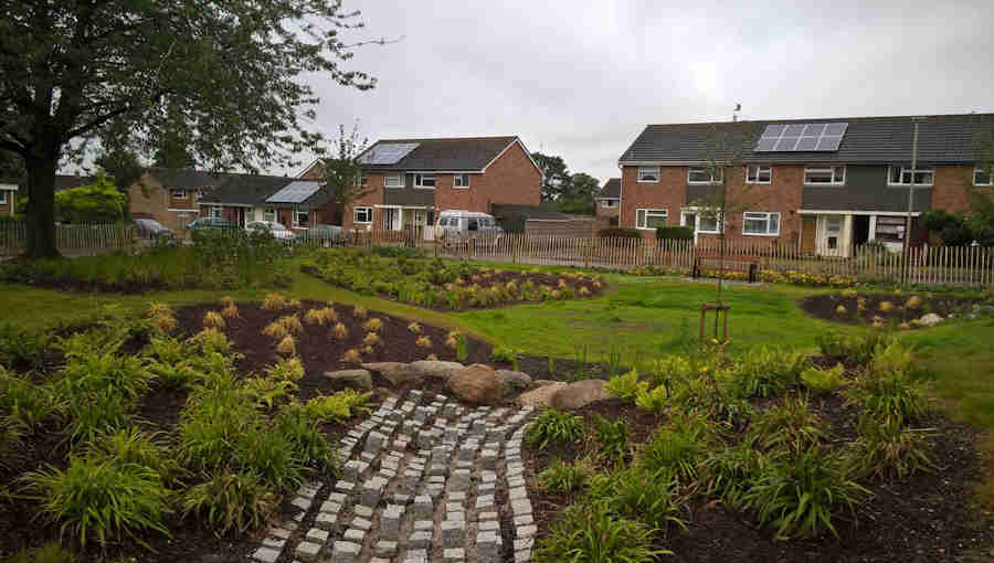 Newly installed sustainable drainage system on a housing estate in Cheltenham