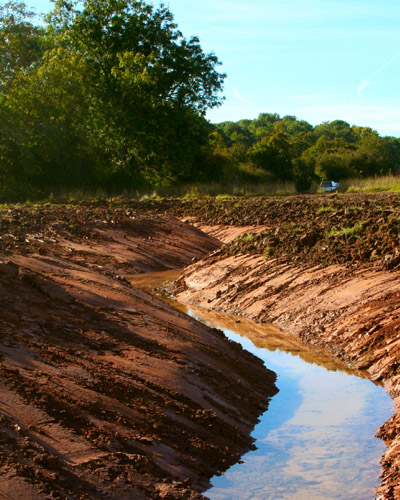 Ditch excavation to control water levels on a wetland created at Hartpury, Gloucestershire