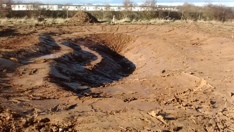 Pond excavation works for a pond construction for great crested newts on a holiday park in Filey, North Yorkshire