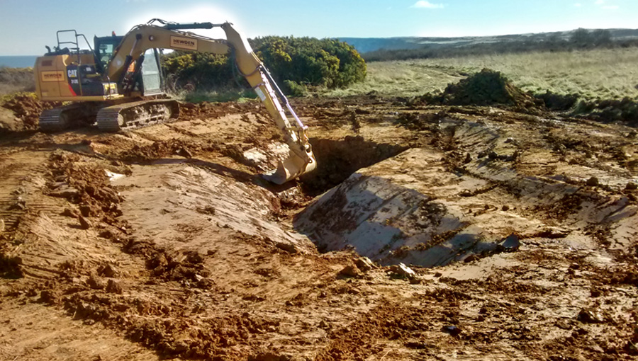 Earthworks for pond construction for great crested newts on a holiday park in Filey