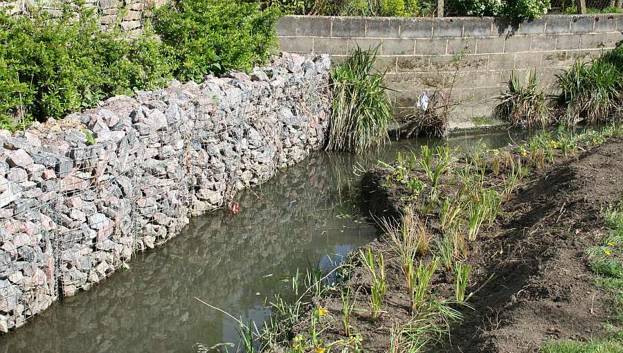 Stone gabions and coir roll installation to control erosion on a bank in Gloucester