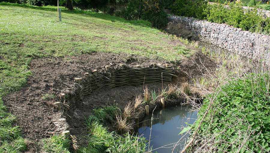 live willow spiling and coir roll installation to control erosion on a bank in Gloucester