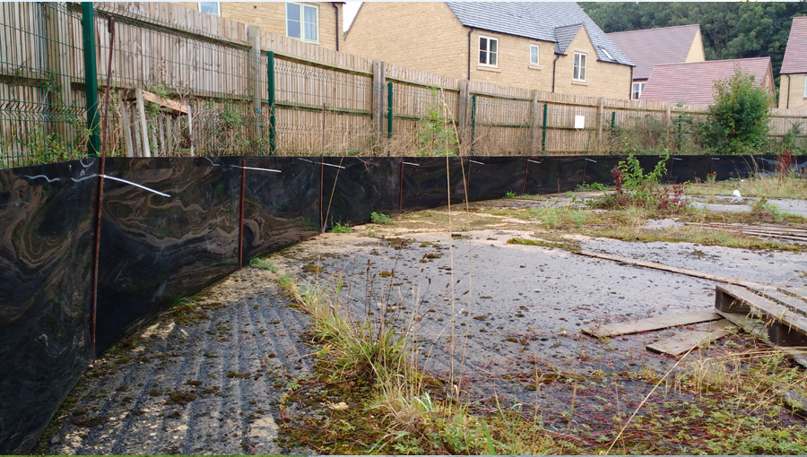 Semi-permanent great crested newt fencing installed on hard standing at Moreton