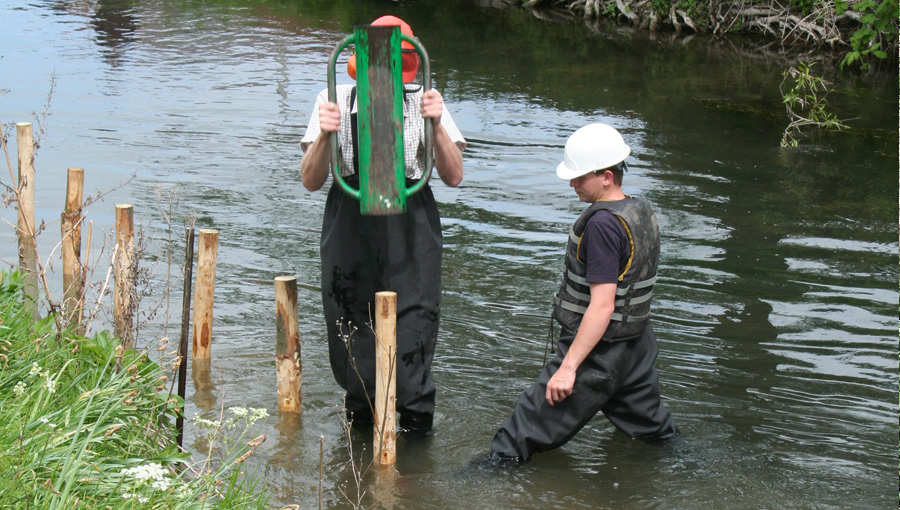 Stake installation for bank reprofiling on the river Avon