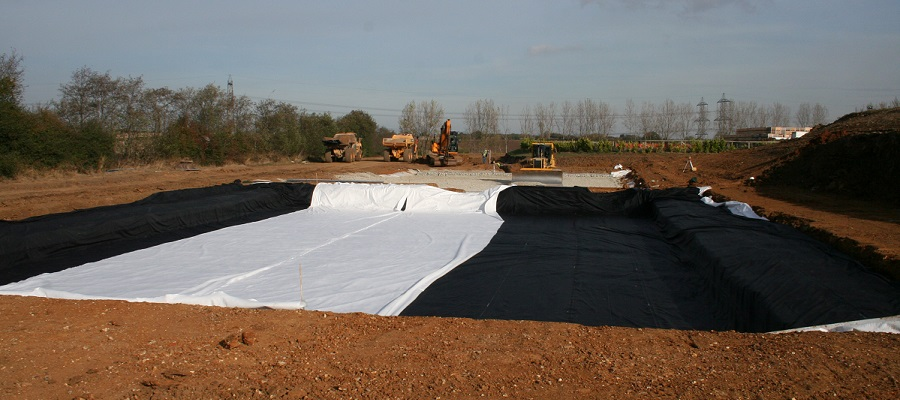 Lining the treatment beds for the sustainable drainage system for Flanders Farm fruit packing centre