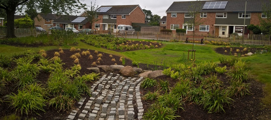 Sustainable drainage system retrofitted to a housing estate in Cheltenham