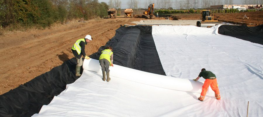 Lining the reedbeds being constructed to treat washings at Flanders Farm fruit packing plant