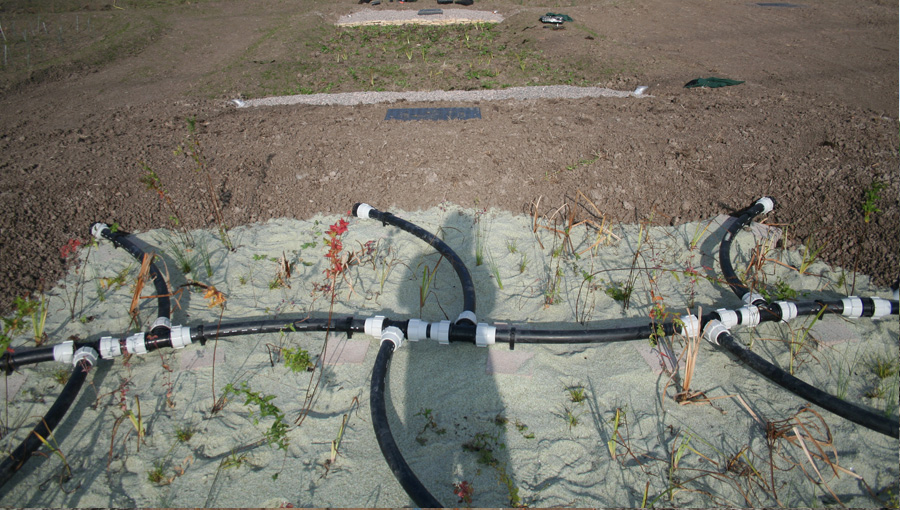 Water treatment system pipework at Steart Marshes