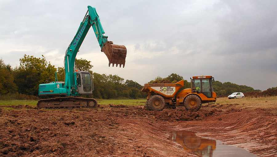 Ditch excavation and earthworks on the wetland creation project at the National Perry Pear Centre in Hartpury, Gloucestershire