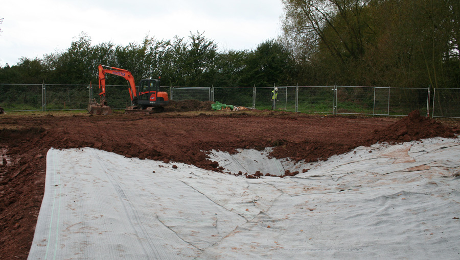 Installation of lining in a newly constructed pond on a housing estate for Crest Nicholson in Holmer